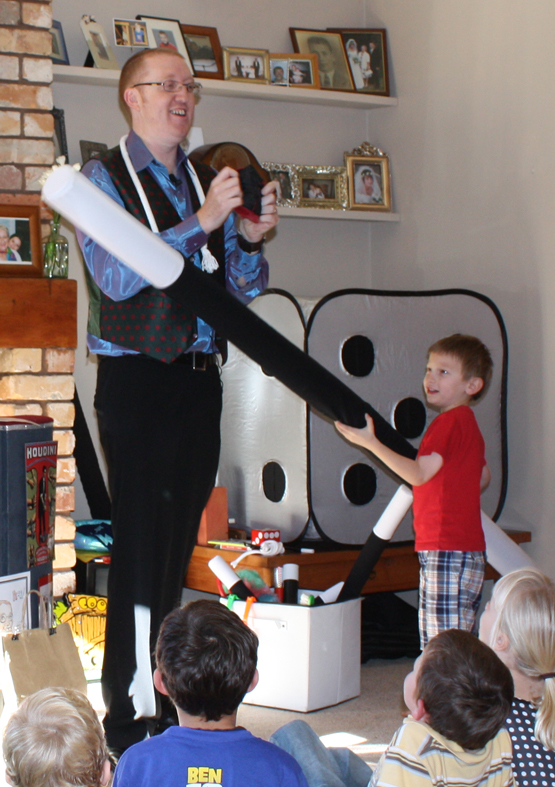 Children play magic tricks with magician Andy Kean